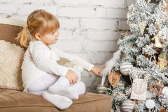 Happy girl near Christmas tree. Stock Images