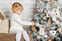 Happy girl near Christmas tree. Stock Photos