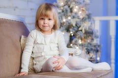 Happy girl near Christmas tree. Stock Photo