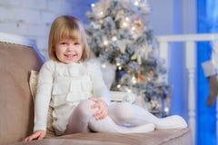 Happy girl near Christmas tree. Royalty Free Stock Photos