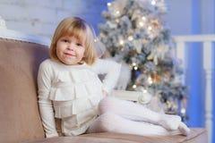 Happy girl near Christmas tree. Royalty Free Stock Photography