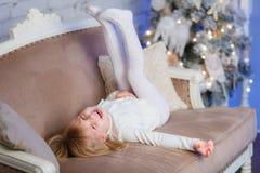 Happy girl near Christmas tree. Royalty Free Stock Photo