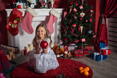 Happy girl near Christmas tree Royalty Free Stock Photos