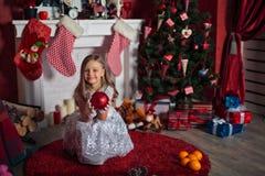 Happy girl near Christmas tree Royalty Free Stock Photos