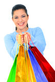 Happy Girl Offer Shopping Bags. Beautiful young woman carrying shopping bags. isolated stock photos