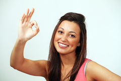 Happy girl ok hand sign Stock Image