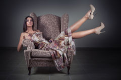 Happy girl in old chair Royalty Free Stock Photography