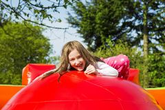 Free Happy Girl On Inflate Castle Royalty Free Stock Images - 129164389