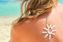 Happy Girl On The Sea With A Picture Of The Sun On Her Back Royalty Free Stock Photos