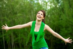Happy girl with open arms outdoors. Stock Image