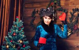 Happy girl opening christmas present box Stock Photo