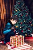 Happy girl opening christmas present box Stock Photography