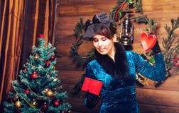 Happy girl opening christmas present box Royalty Free Stock Photo