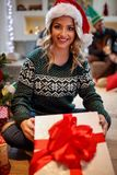 Girl opening gift for Christmas Royalty Free Stock Photo