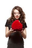 Happy girl opening a gift on Valentine\'s Day Royalty Free Stock Images