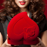Happy girl opening a gift on Valentine's Day Royalty Free Stock Photos
