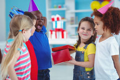 Happy girl opening a present Royalty Free Stock Photography