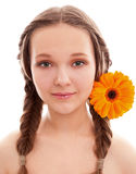 Happy girl with orange flower Royalty Free Stock Photo