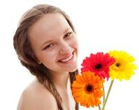 Happy girl with orange flower Royalty Free Stock Photos