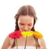 Happy girl with orange flower Royalty Free Stock Photo