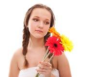 Happy girl with orange flowers Royalty Free Stock Image