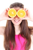 Happy girl with oranges instead her eyes Stock Photos
