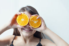 Happy girl with oranges. Summer mood. Stock Photography