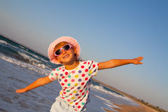 Happy girl outdoors on the beach Royalty Free Stock Images