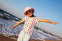 Happy girl outdoors on the beach Stock Image