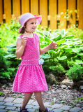 Happy Girl Outside in a Summer Dress and Hat Stock Images