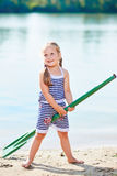 Happy girl with paddle at beach Stock Images