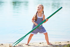 Happy girl with paddle at beach Royalty Free Stock Images