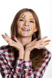 Happy girl with painted face and hands in colorful paints Royalty Free Stock Photos