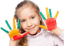 Happy Girl with painted palms Stock Photo