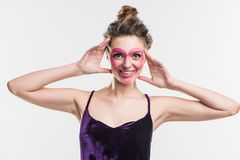 happy girl with painted pink heart on face Stock Images