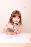 Happy girl painting a bug with marker Royalty Free Stock Images