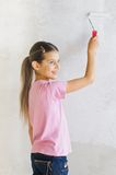 Happy girl painting a wall Royalty Free Stock Images
