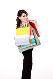 Happy girl with paper bags. Young woman happily shopping full of paper bags Royalty Free Stock Photos