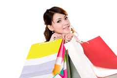 Happy girl with paper bags. Young woman happily shopping full of paper bags Stock Photos