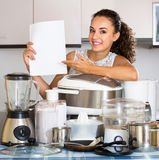 Happy girl with paper and culinary devices Royalty Free Stock Photos