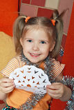 The happy girl with a paper snowflake Royalty Free Stock Photography