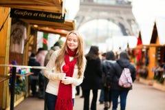 Happy girl on a Parisian Christmas market Stock Image