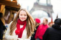 Happy girl on a Parisian Christmas market Royalty Free Stock Image