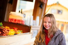 Happy girl on a Parisian Christmas market Royalty Free Stock Images