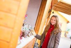 Happy girl on a Parisian Christmas market Royalty Free Stock Photos