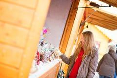 Happy girl on a Parisian Christmas market Stock Photo