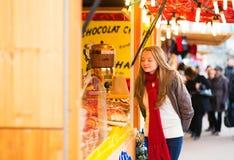 Happy girl on a Parisian Christmas market Stock Photos