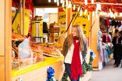 Happy girl on a Parisian Christmas market Royalty Free Stock Photo
