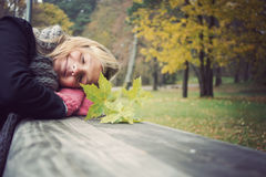 Happy girl in park. Happy girl rests in an autumn park Royalty Free Stock Photography