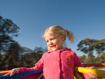 Happy girl in park play ground Stock Photo